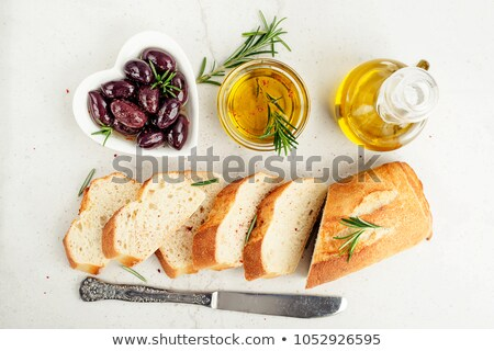 italian food ingredients, rosemary, olives, olive oil and ciabatta bread on wooden background Stock photo © yelenayemchuk