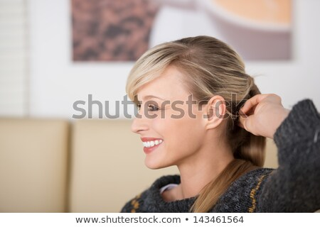 blonde woman holding her hair up in a pony tail  Stock photo © feedough