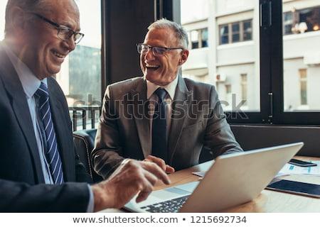 Laughing Businessman Stock photo © filipw