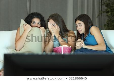 três · mulheres · jovens · assistindo · filme · sessão - foto stock © is2