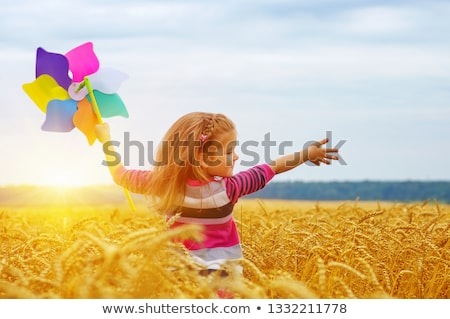 Girl holding windmill in sun Stock photo © IS2