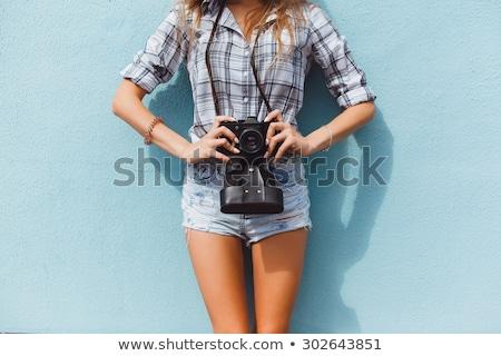 happy brunette woman making photo on retro camera stock photo © deandrobot