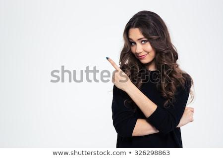 портрет · улыбающаяся · женщина · свитер · указывая · пальца · далеко - Сток-фото © deandrobot