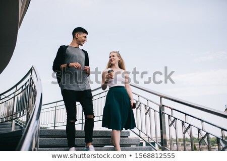 Couple having conversation on the stairs Stock photo © IS2