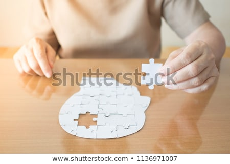 Woman placing missing piece in jigsaw puzzle Stock photo © wavebreak_media