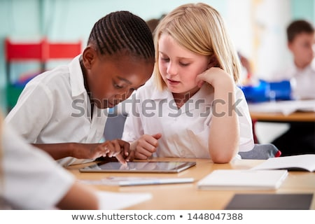 Boy working on a computer at primary school Stock photo © monkey_business