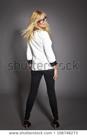 Slender attractive woman in a black outfit Stock photo © Giulio_Fornasar