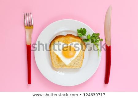 Plaka sahanda yumurta kalp çatal bıçak beyaz Stok fotoğraf © adamson
