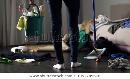 Woman Standing In Messy Room Stock photo © AndreyPopov