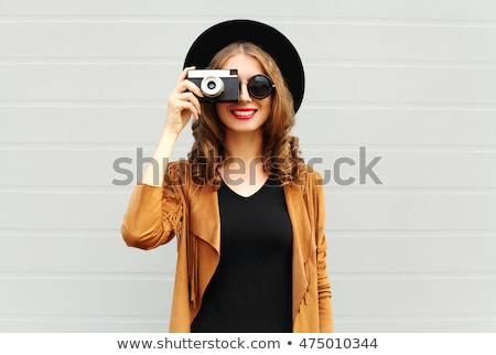 Photo of pretty trendy woman with curly hair in summer wear and  Stock photo © deandrobot