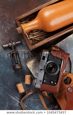 Red wine bottle, corkscrew and old photo camera Stock photo © dash