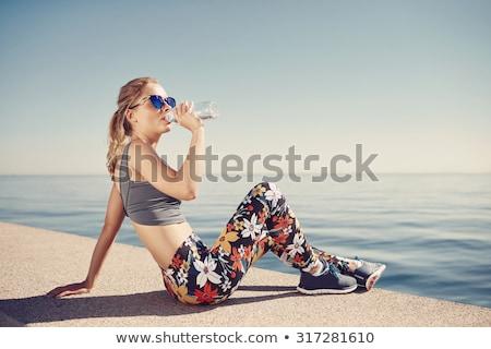 座って · ランナー · 女性 · リスニング · 音楽 · 画像 - ストックフォト © boggy