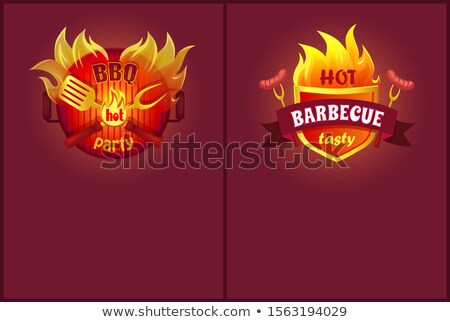 Crossed Spatula and Paddle on Burning Barbeque Stock photo © robuart