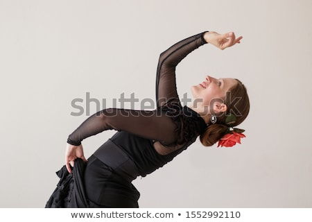young woman dancing flamenco from back isolated on white Stock photo © artjazz