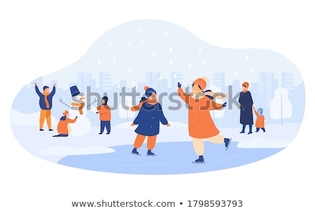 Family Building Snowman in Winter City Town Park Stock photo © robuart