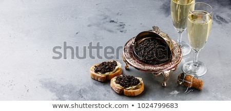 Sturgeon black caviar in bowls Stock fotó © furmanphoto