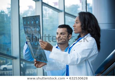Vrouwelijke arts radioloog geïsoleerd witte computer Stockfoto © Elnur