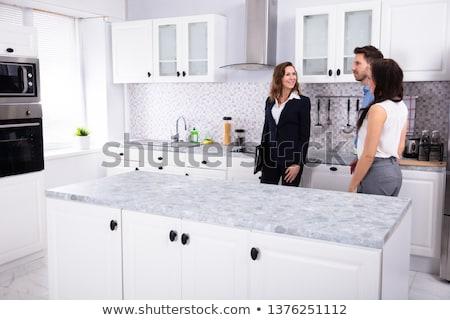 Nő konyhaszekrény fiatal nő megbeszélés ingatlanügynök ház Stock fotó © AndreyPopov