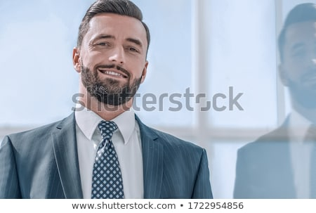 A Man in Suite at the Window Stock photo © artfotodima