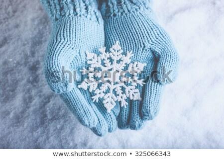 close up of woman holding snowflake on christmas stock photo © dolgachov