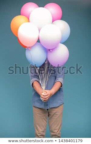 Mature man in casualwear holding bunch of colorful balloons Stock photo © pressmaster