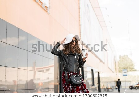 happy women with coffee at vintage clothing store stock photo © dolgachov