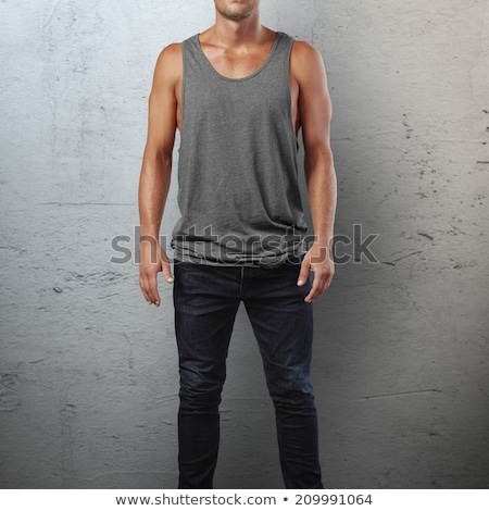 Young man in undershirt and jeans stock photo © nyul