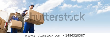 Stock foto: Two Delivery Man Carrying Cardboard Box