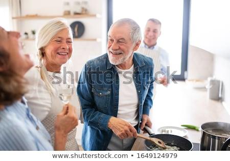 Senior man genieten koken keuken glimlachend Stockfoto © HighwayStarz