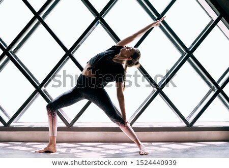 Jovem bela mulher ioga guerreiro pose grande Foto stock © GVS