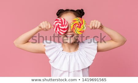 Stock photo: girl and her lollipop