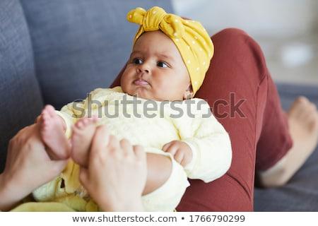 portrait of lying down baby girl stock photo © phbcz