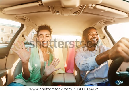 beautiful woman excited after shopping trip stock photo © darrinhenry