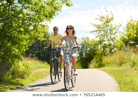 Young couple riding bicycles Stock photo © photography33