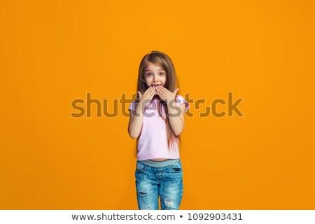 cute · sorprendido · foto · jóvenes · mujer · sonriente - foto stock © yurok