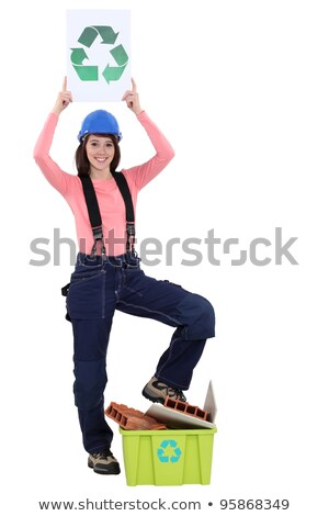 female bricklayer holding recycling logo against white background Stock photo © photography33