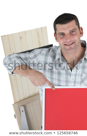 Joiner pointing to red poster board Stock photo © photography33