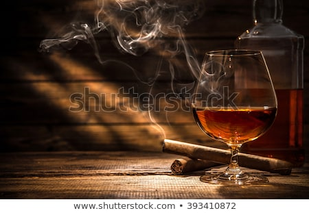 vidrio · whisky · cigarro · superior · piedra - foto stock © bugstomper