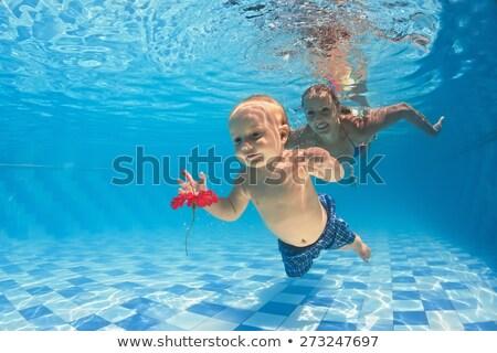mulher · vermelho · flor · piscina · posando · água - foto stock © dash