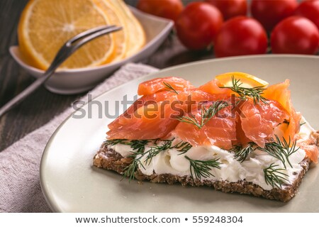 close-up of smoked salmon  with tomato and lemon Stock photo © ozaiachin