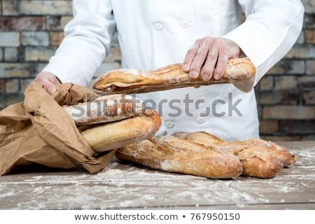 Baker baguettes sonrisa restaurante pan chef Foto stock © photography33