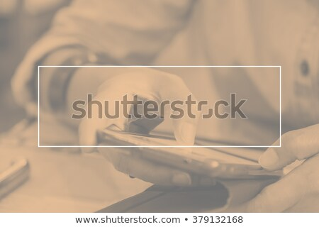 Stock photo: smart duo on cell phone