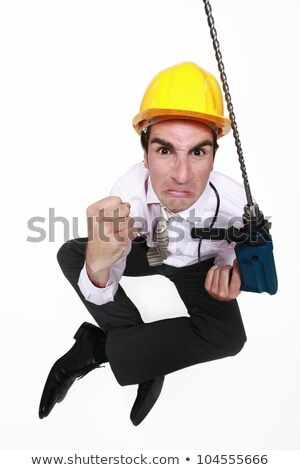 A pissed architect with a drill. Stock photo © photography33