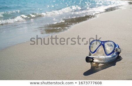 snorkel and mask on sandy beach stock photo © ellensmile