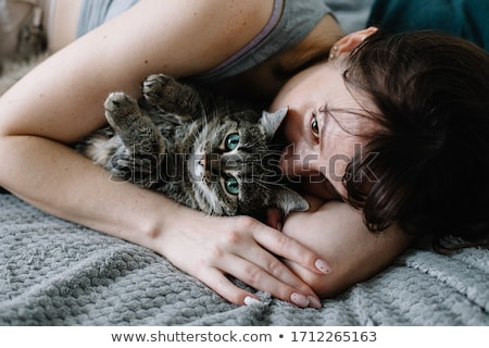 Brunette woman lying on bed in bad mood Stock photo © dash