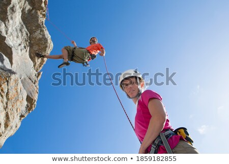 casual man looks down at camera in mountains stock photo © feedough