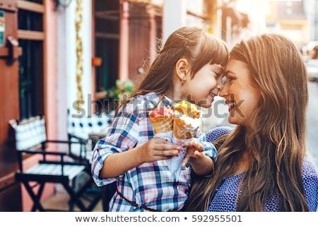 cute little girl eating her ice cream stock photo © ozgur