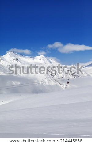 Gondola lift and off piste slope at nice day Stock photo © BSANI