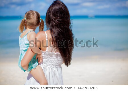 Stock photo: Kid girl rear view in beach tropical turquoise water
