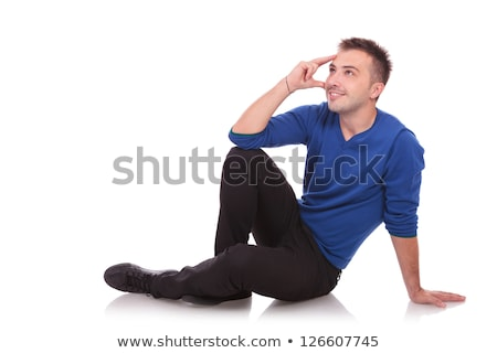 seated young man looking into his future Stock photo © feedough